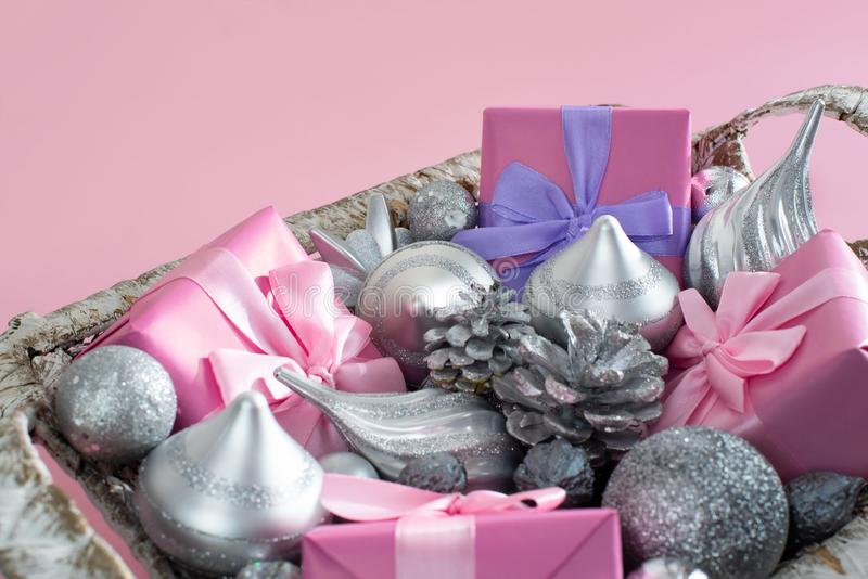 Festive basket with gifts and toys for Christmas Decorative items boxes decoration for the holiday stock photography