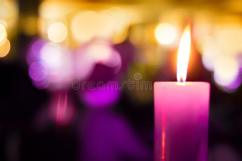 Festive Beautiful blurred Background with single burning candle royalty free stock photography