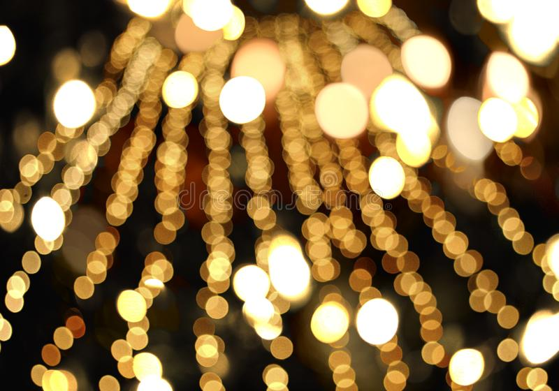 Festive blurred bokeh background, gold, sparkle, glitter,, night. Abstract background black blurred bokeh bright Christmas circle color holiday decoration design royalty free illustration