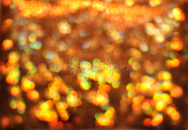 Festive bokeh background, gold, yellow, orange and green lights, defocused, christmas or new year celebration, greeting card, par stock images