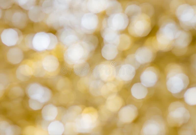 Festive bokeh background. Golden Christmas light blur background royalty free stock images