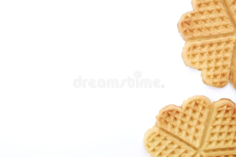 Festive breakfast composition with homemade waffles in the shape of heart for valentine`s day. royalty free stock photography