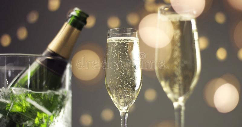 Festive bubbles in a glass of sparkling wine royalty free stock image