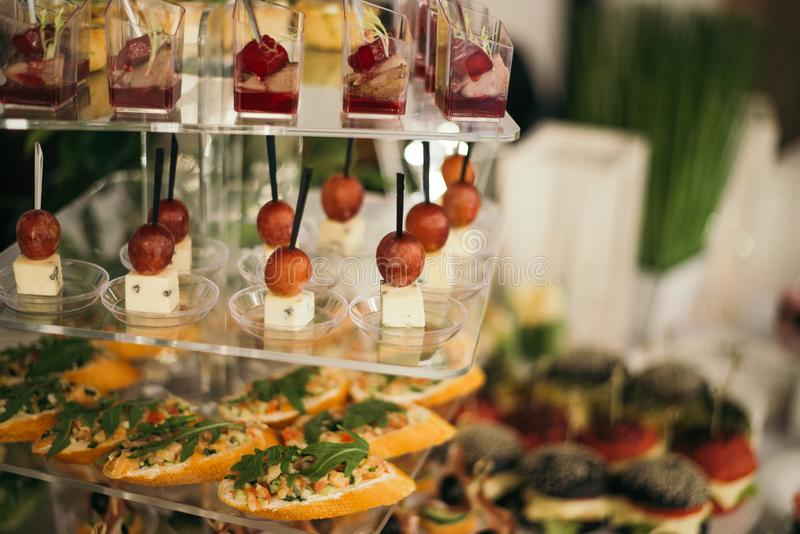 Festive buffet. kind of dishes. meat and vegetables. salads, snacks. wedding reception royalty free stock image