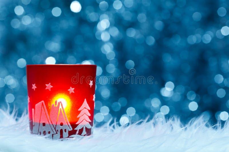 Festive candle holder. Over blue shiny background, Christmas concept stock image
