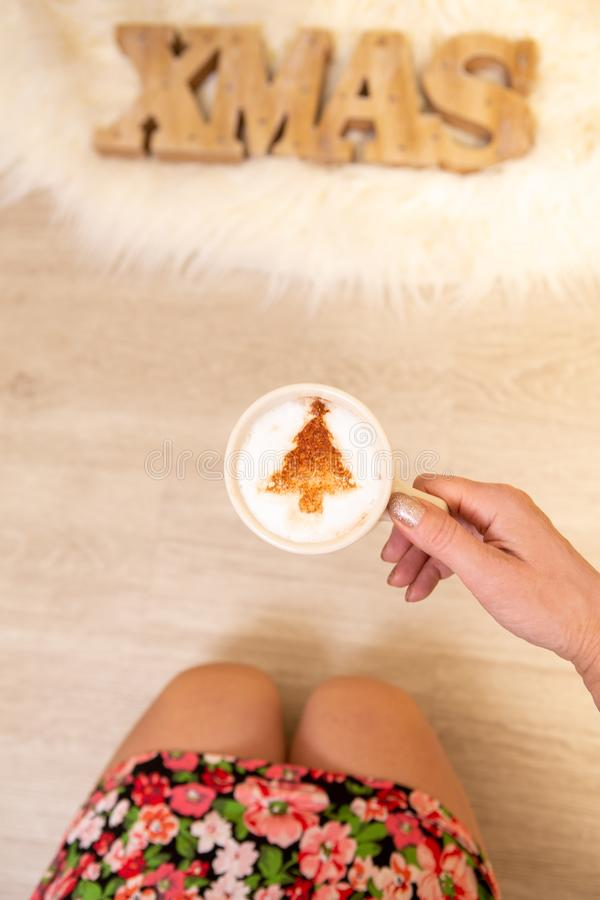A festive cappuccino decorated with chocolate Christmas tree royalty free stock photo