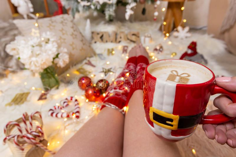 Festive Christmas ornaments fairy lights and cappaccino stock photos