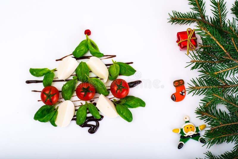 Festive Christmas appetizer caprese salad shaped Christmas tree stock photography