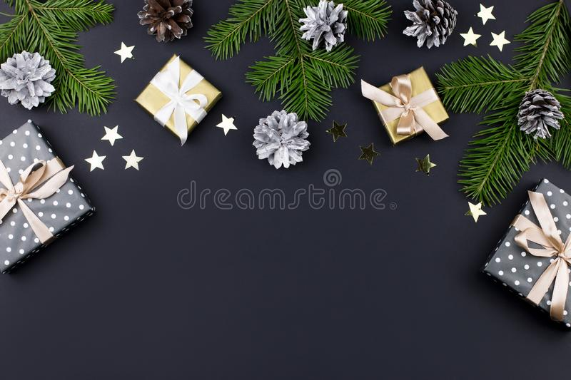 Festive Christmas background with fir branches, giftboxes, decorations, copy space, top view stock photo
