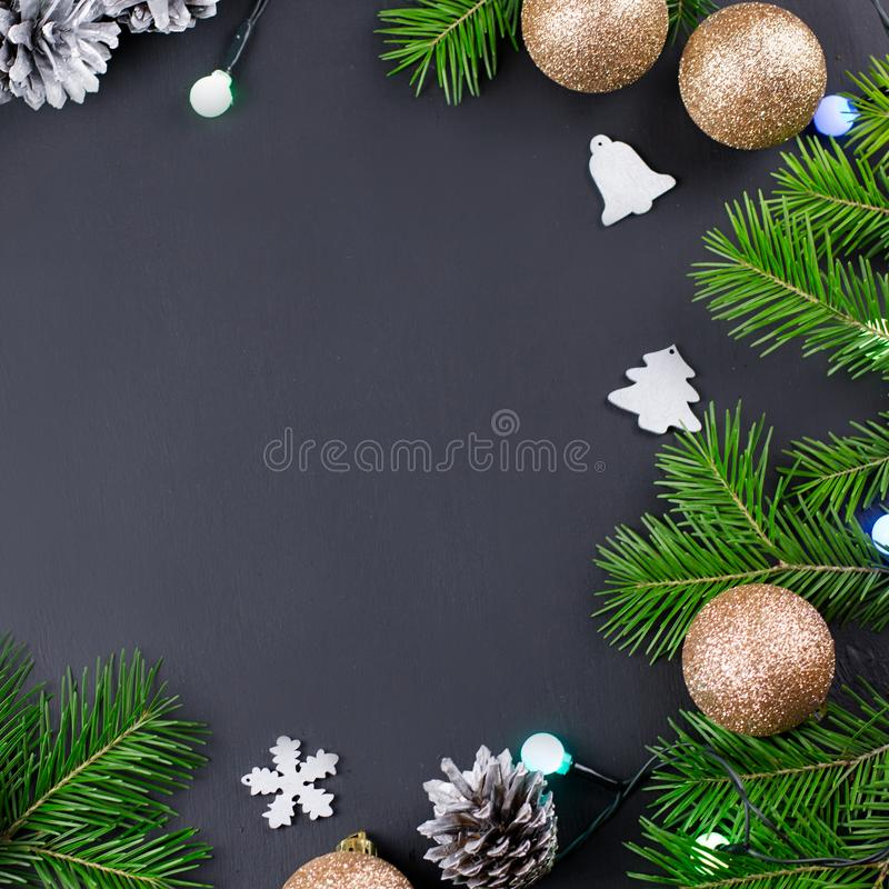 Festive Christmas background with fir branches, giftboxes, decorations, copy space, top view. Festive Christmas background with fir branches, giftboxes royalty free stock photography