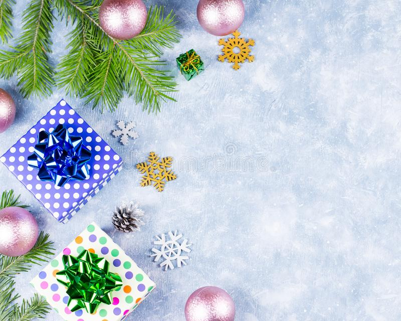Festive Christmas background with fir branches, Christmas symbols, presents, colorful decorations, copy space stock photo