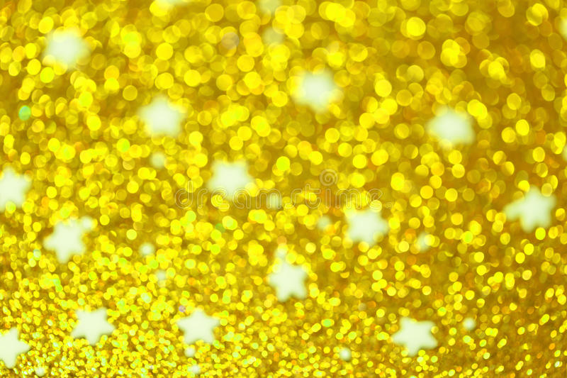 Festive Christmas background with stars. Abstract twinkled bright background with bokeh defocused lights royalty free stock photography