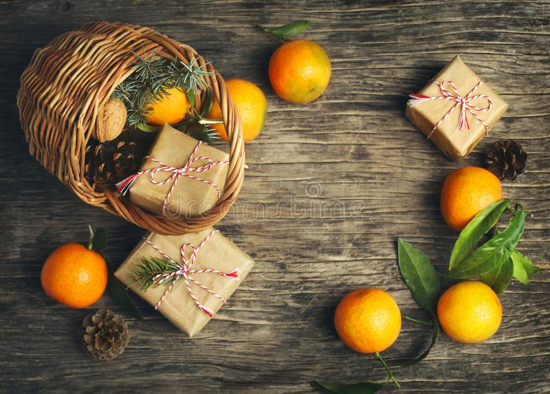 Festive Christmas Basket with gift boxes and tangerines royalty free stock photo
