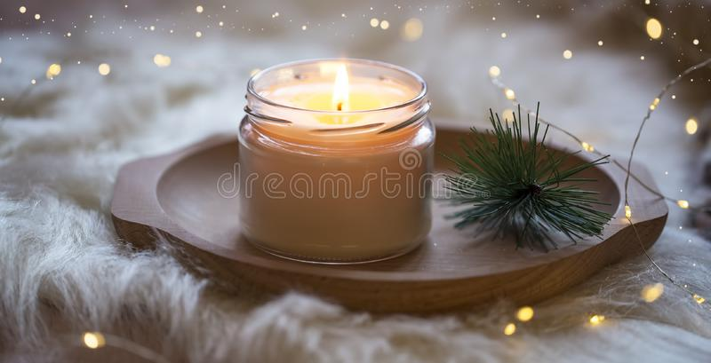 Festive Christmas candle , holiday winter decoration candle. Light with sparkle lights stock images
