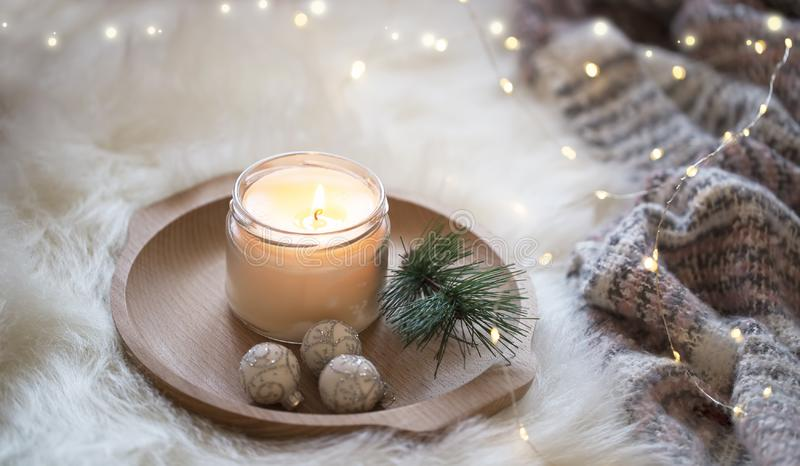 Festive Christmas candle , holiday winter decoration candlelight. With sparkle lights royalty free stock images
