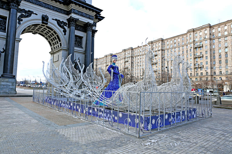 Festive Christmas composition - figure Snow Maiden (Snow Queen). In sleigh near the Arc de Triomphe in Moscow stock images