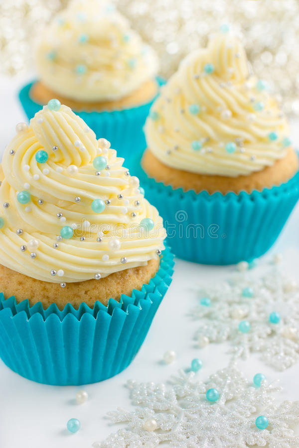 Festive Christmas cupcake. With frosting and sugar decoration stock photography