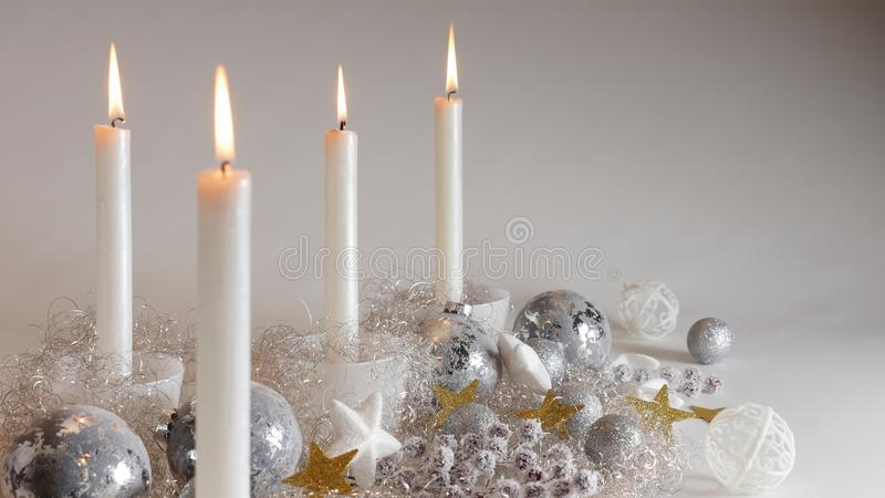 Festive Christmas decoration with four candlelights, glitter balls and sparcling angel hair royalty free stock photography