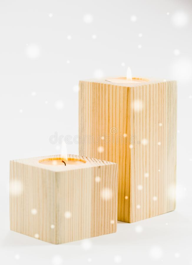 New Year`s decor. Burning holiday candles on a white background royalty free stock photo