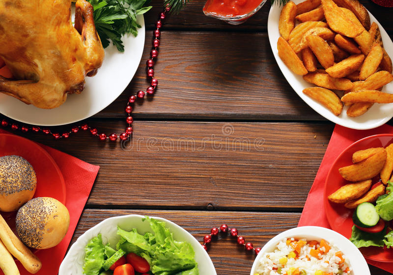 Festive Christmas dinner with baked chicken, potatoes royalty free stock photos