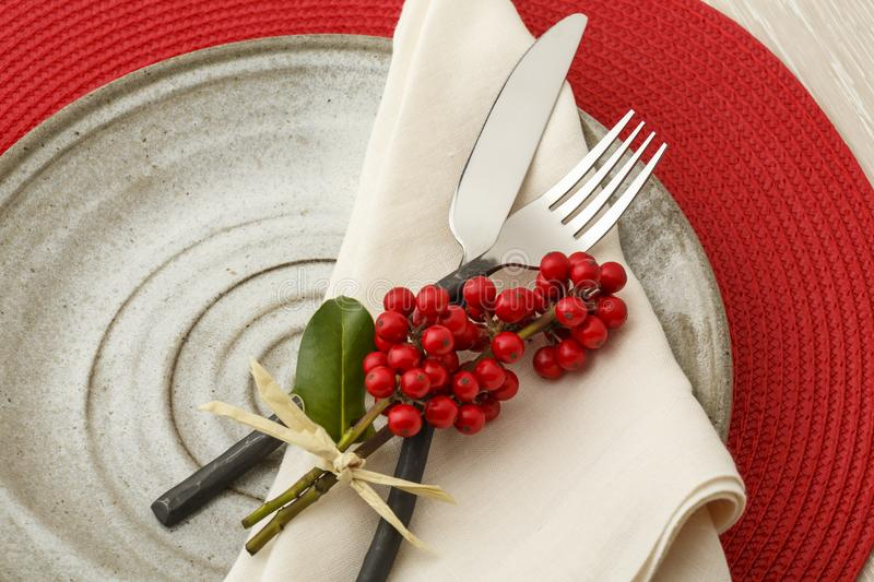 Festive Christmas dinner table setting place setting with natural botanical decorations. Festive Christmas dinner table setting place setting with rustic royalty free stock photography