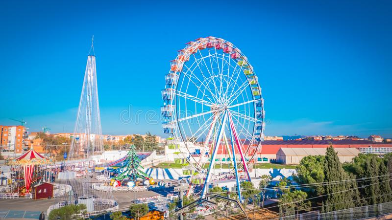 Festive Christmas fair with a Ferris wheel in Torrejon de Ardoz near Madrid, Spain. Torrejon de Ardoz, Madrid / Spain - 12 05 2018: Magicas Navidades Christmas stock photography