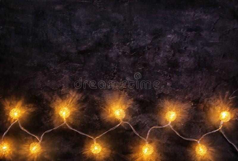 Festive Christmas lights. On dark background stock photo