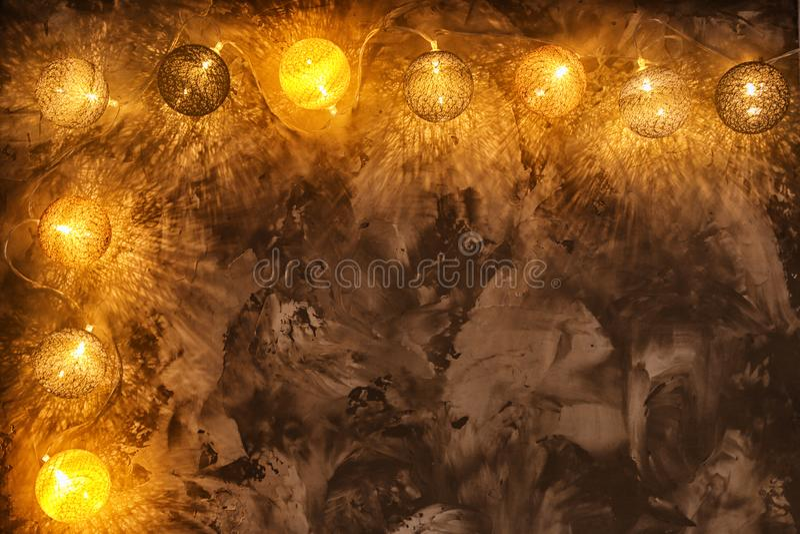 Festive Christmas lights. On grey background royalty free stock image