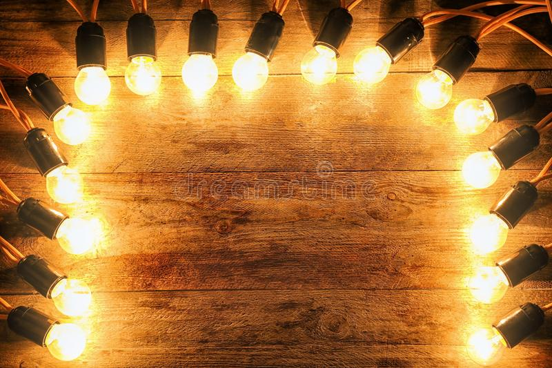 Festive Christmas lights. On wooden background stock images