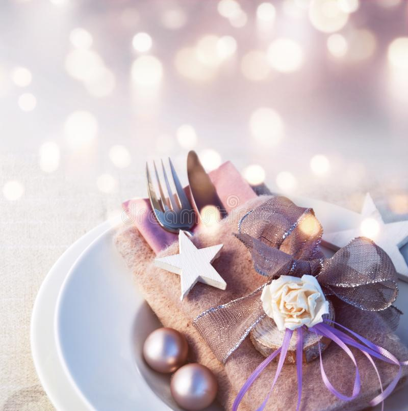 Festive christmas place setting. With tender pink background and golden bokeh royalty free stock image