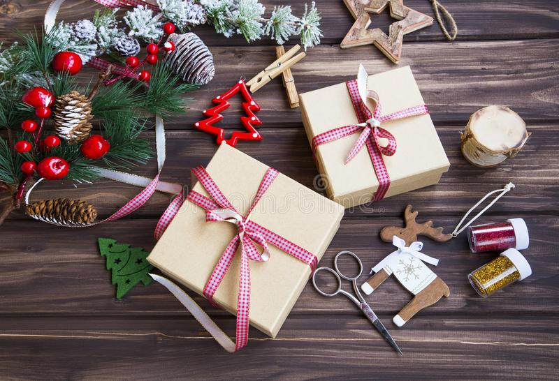 Festive Christmas presents with green ribbon, fir tree branches a stock photography