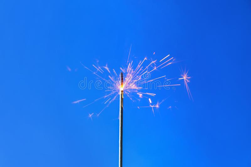 Festive Christmas sparkler on color background stock images