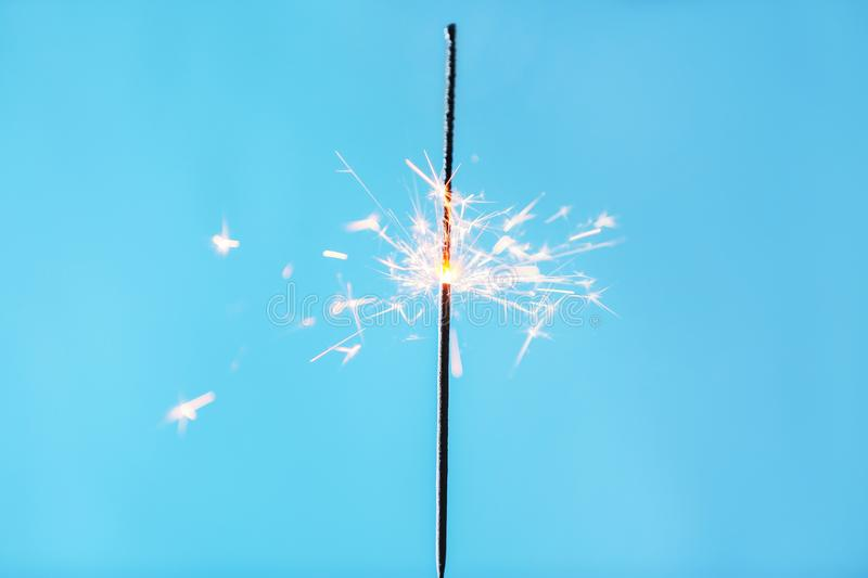 Festive Christmas sparkler on color background stock photography