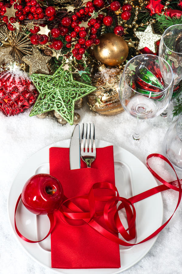 Festive christmas table place setting with red decoration