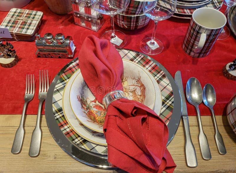 Festive Christmas Table setting. Festive holiday Christmas table setting with red plaid theme royalty free stock photos