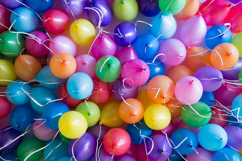 Festive, colorful balloons with helium attachment to the white ribbons. Festive, colorful balloons with helium. attachment to the white ribbons stock photos