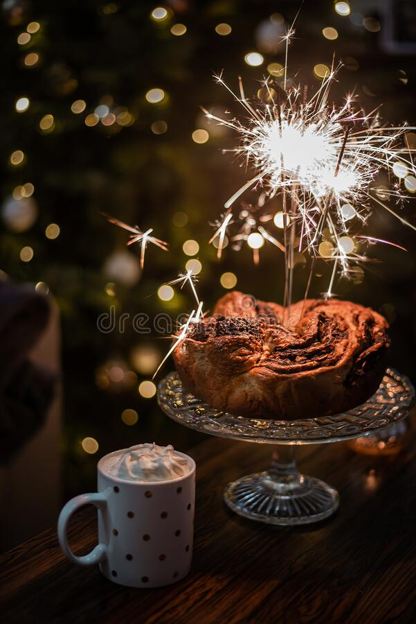 Festive comfort food decorated with sparkles - home baked chocolate wreath with hot cocoa with whipped cream. stock photography