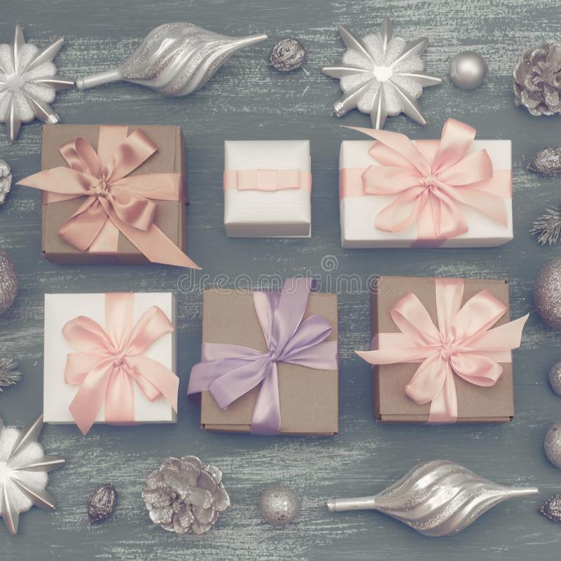 Festive composition flat lay Christmas toy balls cones snowflakes silver box wooden vintage background. stock photos