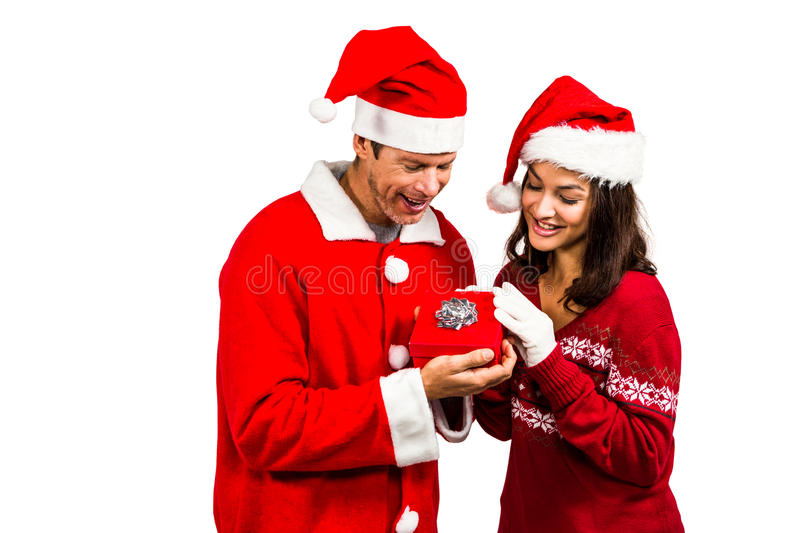 Festive couple exchanging a gift. On white background royalty free stock image