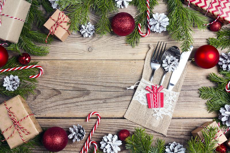 Festive cutlery and Christmas decorations on old wooden table. C stock photos