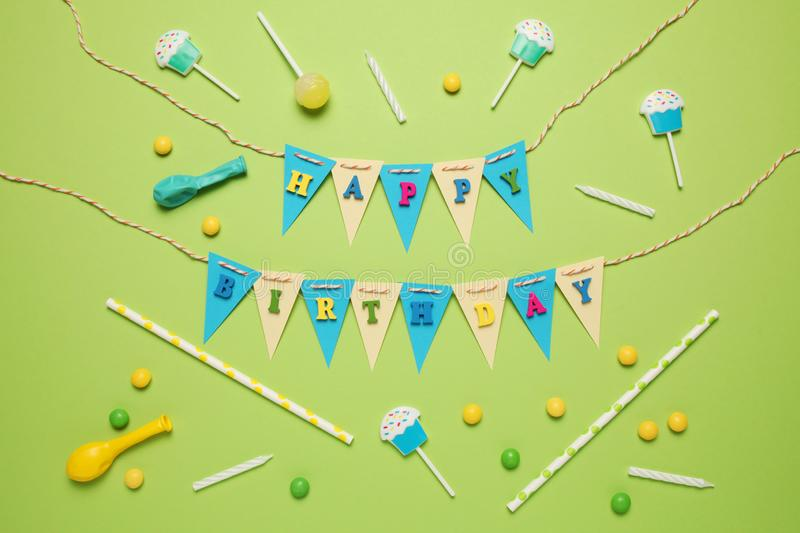 Festive decor for children`s birthday. Sweet multicolored candies, balloon, straws.  stock photography