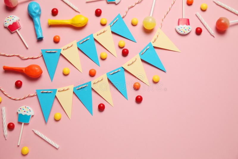 Festive decor for children`s birthday. Sweet multicolored candies, balloon, straws.  stock images