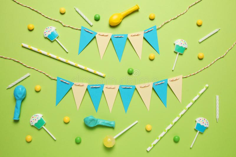 Festive decor for children`s birthday. Sweet multicolored candies, balloon, straws.  stock photo