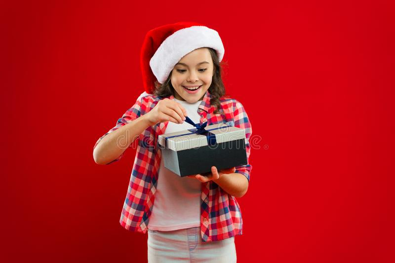 Festive decor. New year party. Santa claus kid. Little girl child in santa red hat. Present for Xmas. Childhood. Happy royalty free stock photos