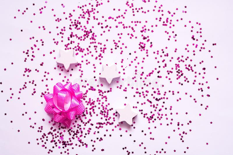 Festive decorations. Wooden and purple stars on white background. stock photos