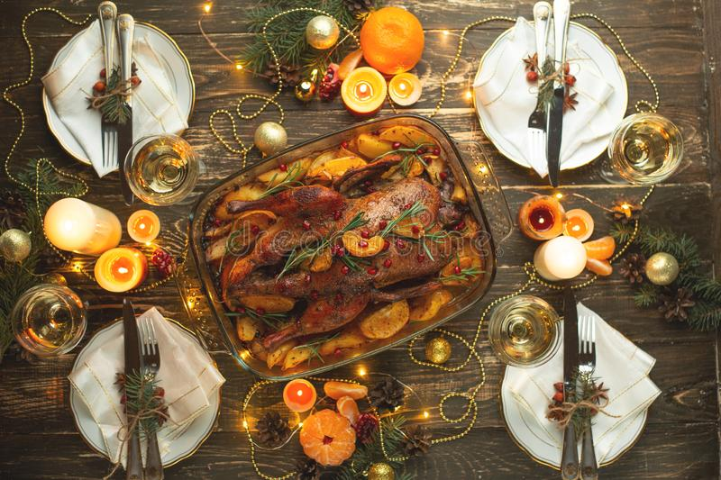 Festive dinner, baked delicious duck with fruits, flat lay, festive table setting, background for menu, restaurant, recipe book royalty free stock photos