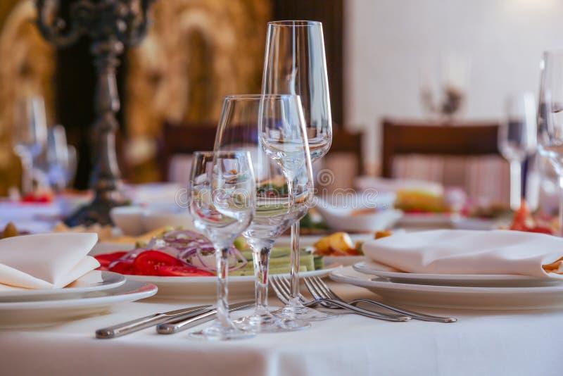 Festive dinner table inside a restaurant. Festive dinner table  and starters inside a restaurant stock images