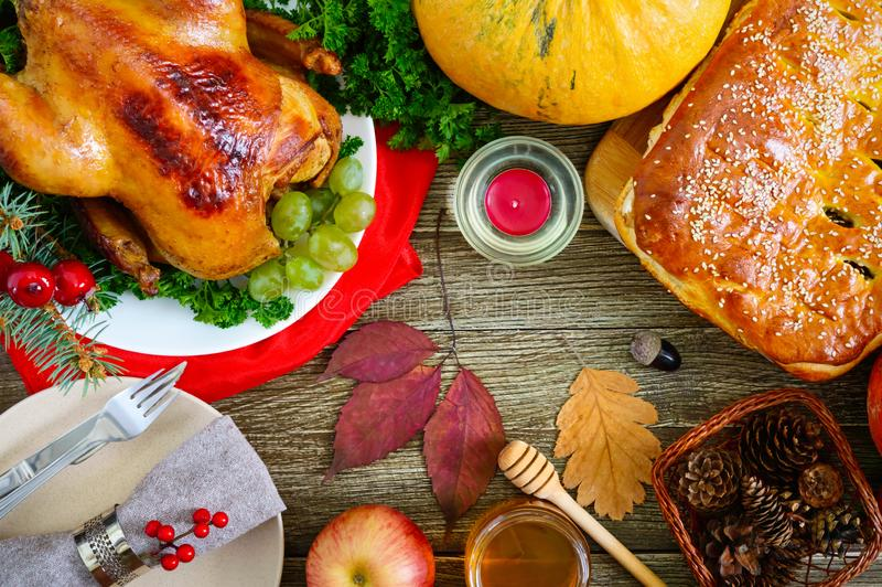 Festive dinner for Thanksgiving. Traditional Thanksgiving dishes: turkey, pumpkin pie stock image