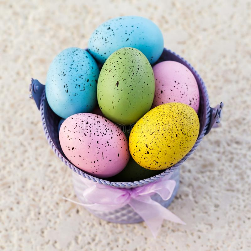Festive Easter eggs in a bucket for traditional holiday. Image royalty free stock photo
