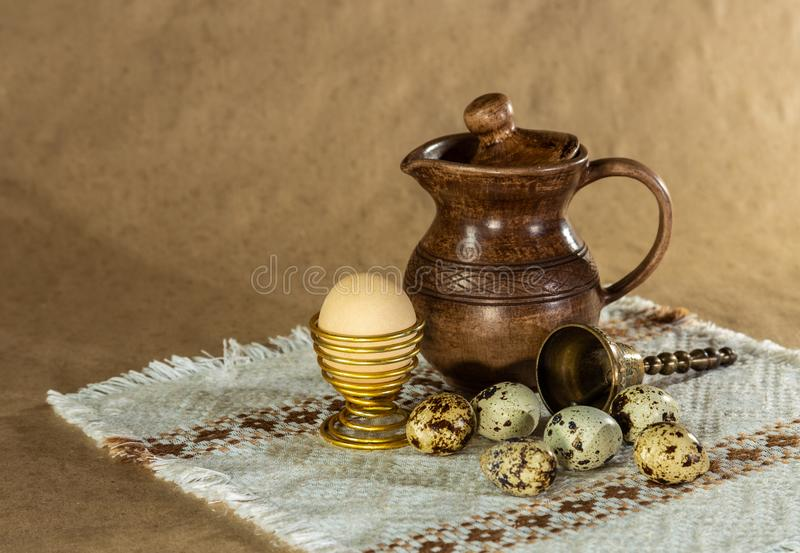 Festive Easter still life with eggs and earthenware jug. Blank for postcards royalty free stock image